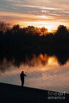 Fisherman at the Cove by Marcel  J Goetz  Sr