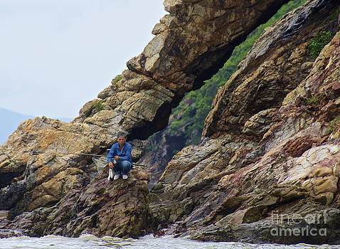 Fisherman on Rocks  by Sarah Mullin