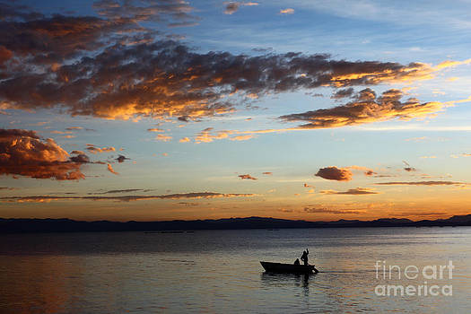 James Brunker - Fishing at Sunset on Lake Titicaca
