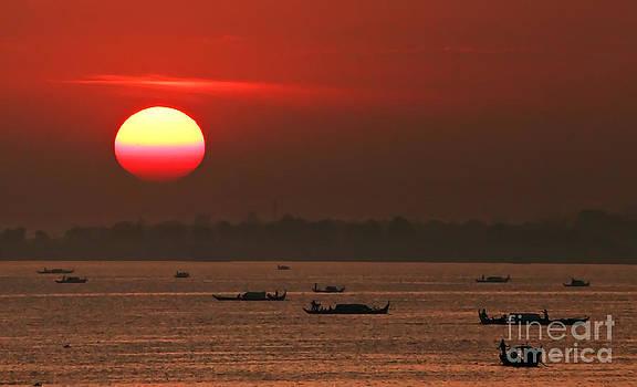 Fishing boats at sunrise by Jojie Alcantara