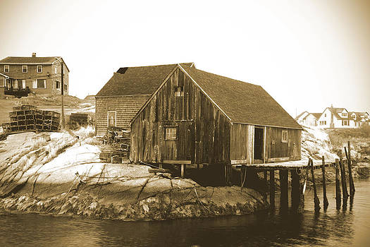 Fishing wharf at Peggy's Cove by Gordon  Grimwade