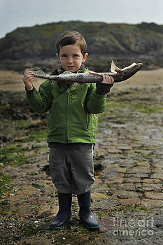 French boy with fish by Tina Osterhoudt