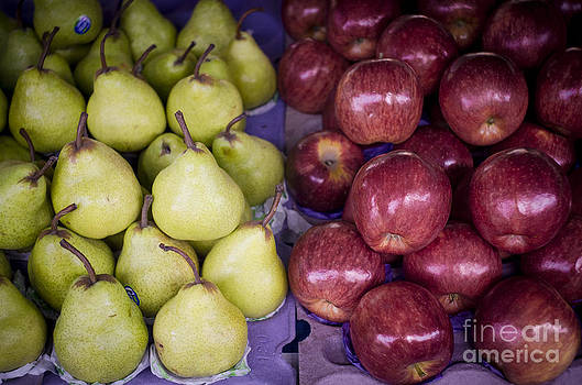 Fresh apples and pears on a street fair in Brazil by Ricardo Lisboa