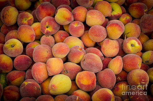 Fresh peaches on a street fair in Brazil by Ricardo Lisboa