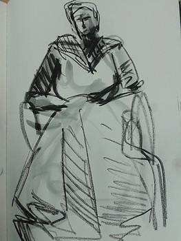 Frida sits by Tali Farchi