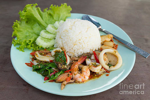 fried seafood with basil leaves on Steamed rice. by Tosporn Preede