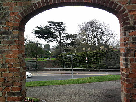 Gardens through the archway by Geoff Cooper