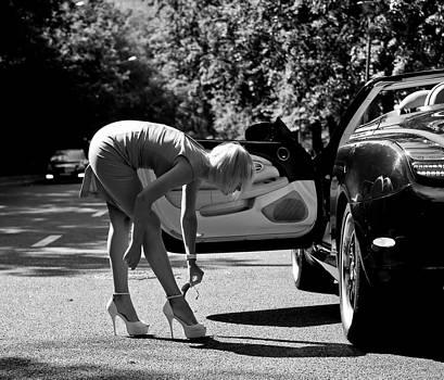 Girl and Lexus by Oleg Koryagin