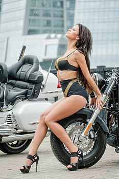 Girl and motorcycles by Oleg Koryagin
