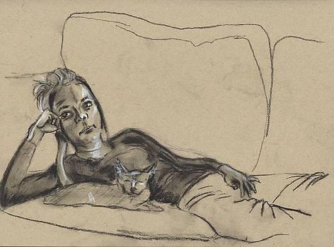 Girl with cat at sofa by Drew Eurek