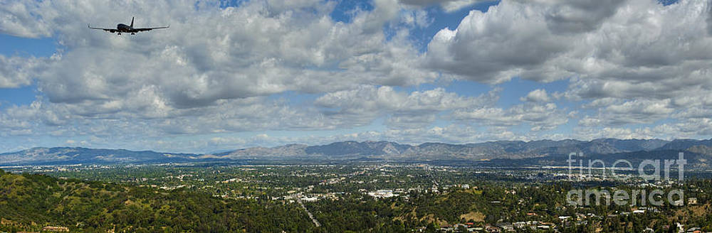 David  Zanzinger - Going Places Plane leaving San Fernando Valley Cloudy Blue Sky Panoramic