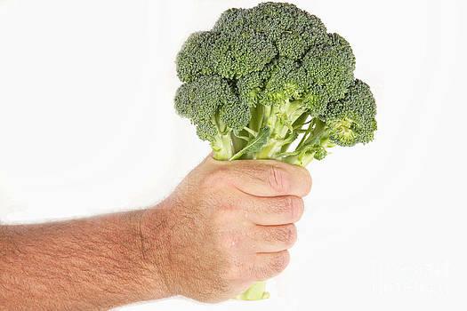 James BO  Insogna - Hand Holding Broccoli