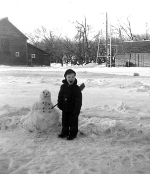 Jay Petersen Age 4 with my snowman on the Farm by Jay Kyle Petersen