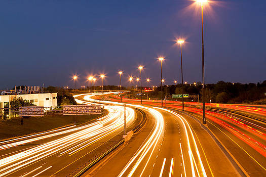 Highway at night. by Tibor Co