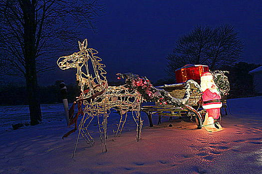 Horse Drawn Sleigh and Santa at Night by Suzanne DeGeorge