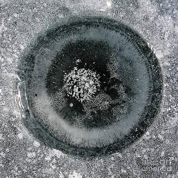 Steven Ralser - ice fishing hole 9