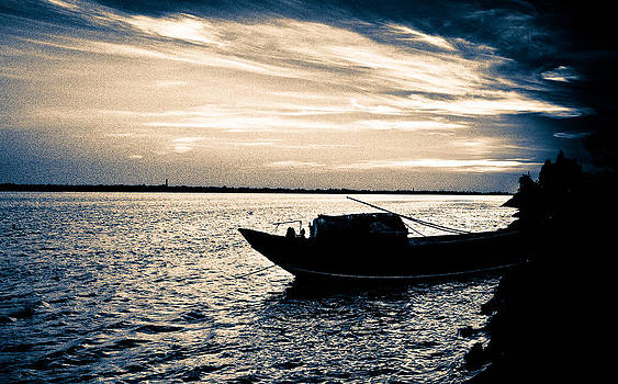 Idle Boat in the Setting Sun by Debjyoti Ganguly