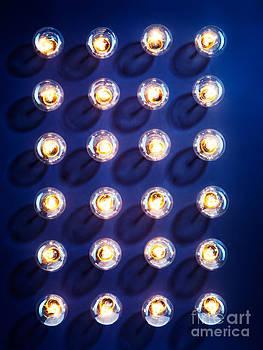 Illuminated light bulbs on blue background by Oleksiy Maksymenko