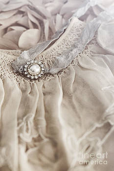 Sandra Cunningham - Infant dress with small pearl jewelery