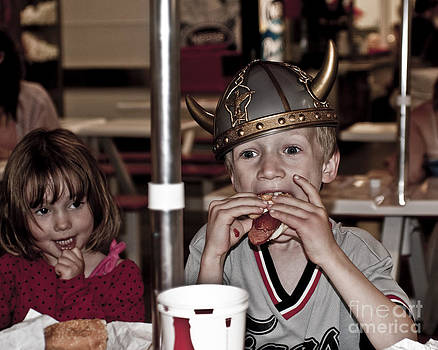 Is She Adoring her Viking or Coveting his Lunch by Sandi Mikuse