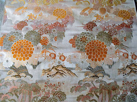 Japanese brocade tapestry banner featuring a floral design and a flying crane.  by Japanese artistry