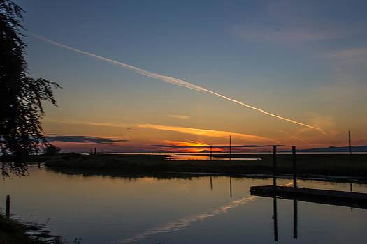Jet Trail Reflection by Melodie Douglas