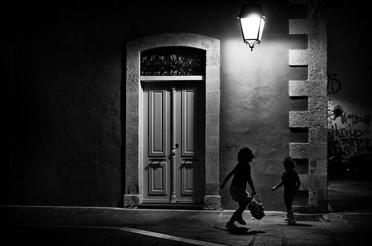 Kids playing in the night by Spyros Papaspyropoulos