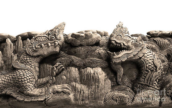 King Of Nagas And Kylin Carving On Teak by Pakorn Kitpaiboolwat