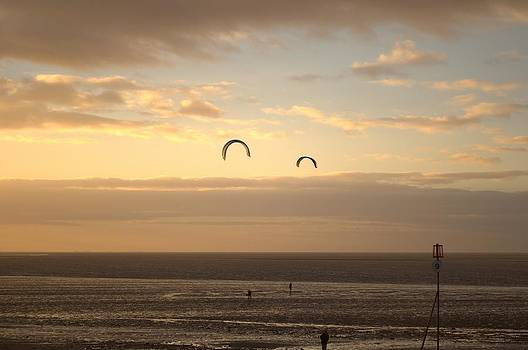 Kites at sunset by Dave Woodbridge