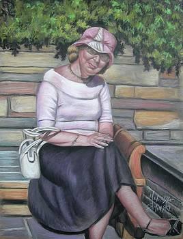 Lady Sitting on a Bench with Pink Hat by Melinda Saminski