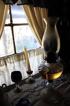Lantern in the window. by Ian  Ramsay