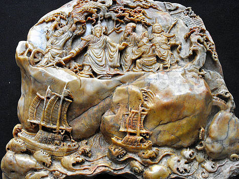 Large Shou Shan carving featuring the emperor and entourage on upper part and sampans on stormy sea by Anonymous artist