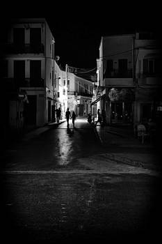 Late night walkers by Spyros Papaspyropoulos