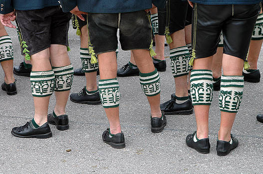 Legs of men with traditional bavarian half stockings by Angela Kail