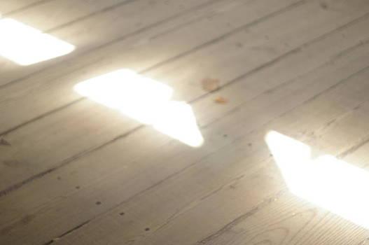 Light Beams on Covered Bridge Floor by Claudia Smaletz