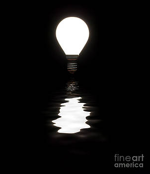 Simon Bratt Photography LRPS - Light bulb shining with reflection in water on black