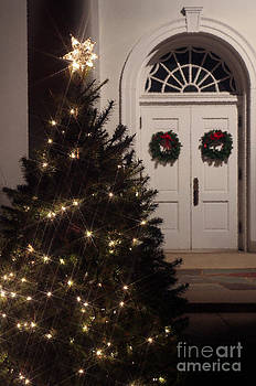 Lighted Christmas Tree with Church Doors at Night by Karen Lee Ensley