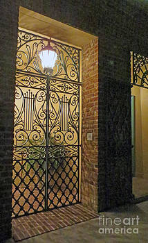 Lighted Wrought Iron Gate and Brick by Lisa Jones