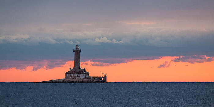 Lighthouse in dusk by Davorin Mance