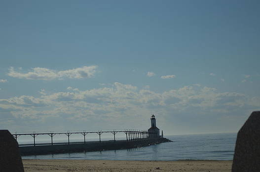 Lighthouse on clear day. by Cim Paddock