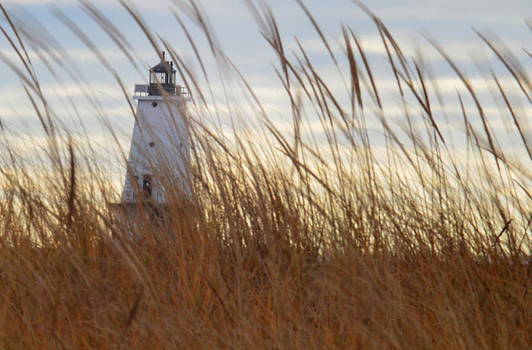 Lighthouse through the grass by Xcape Photography