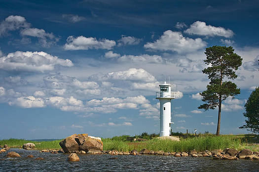 Lighthouse with beautiful clouds by Anna Grigorjeva
