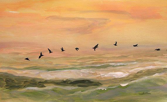 Line of pelicans by Julianne Felton