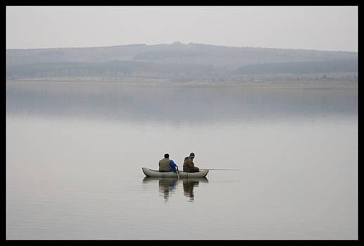 Lonely fishermen  by Peter Til