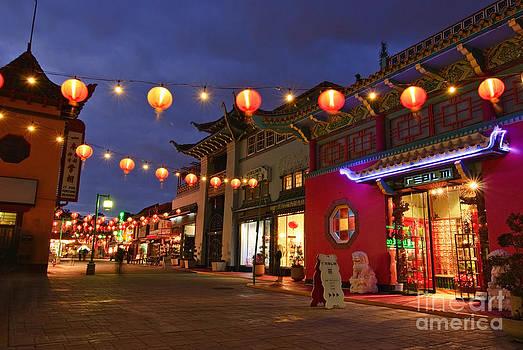 Jamie Pham - Los Angeles Chinatown plaza with lit lanterns and neon lights.