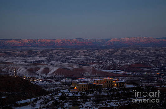 Magic Light Red Rocks with Snow by Ron Chilston