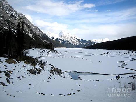 Maligne River with Rocky Mountain Ranges in Jasper National Park Canada by Aeris Osborne