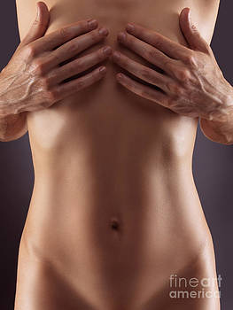 Man hands covering nude woman breasts by Oleksiy Maksymenko