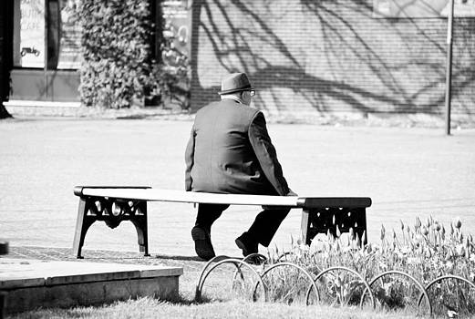 Man on a bench by Hildur Valgeirsdottir