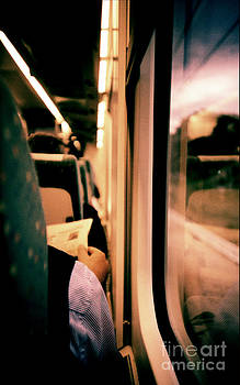 Man on train - Lomo LCA xpro lomographic analog 35mm film by Edward Olive